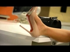 Secretary at her desk (shoeplay) in C. Louboutin pigalle pumps stiletto (12.5cm)